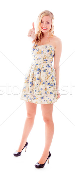 Beautiful young woman standing and showing thumbs up sign Stock photo © bmonteny