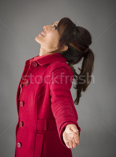 Side profile of an Indian young woman with arms outstretched and day dreaming Stock photo © bmonteny