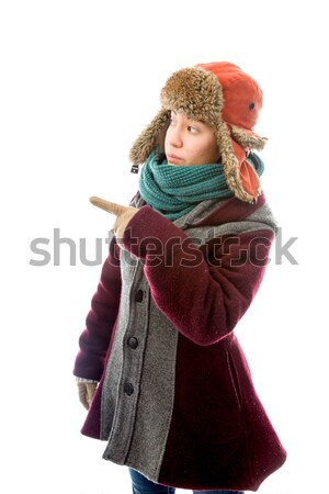 Young woman in warm clothing with finger on lips Stock photo © bmonteny