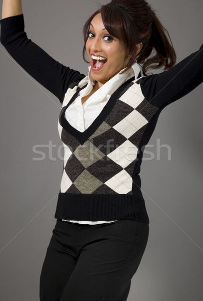 Indian businesswoman jumping in air and laughing Stock photo © bmonteny