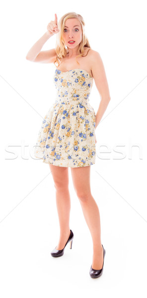 Beautiful young woman standing and pointing Stock photo © bmonteny