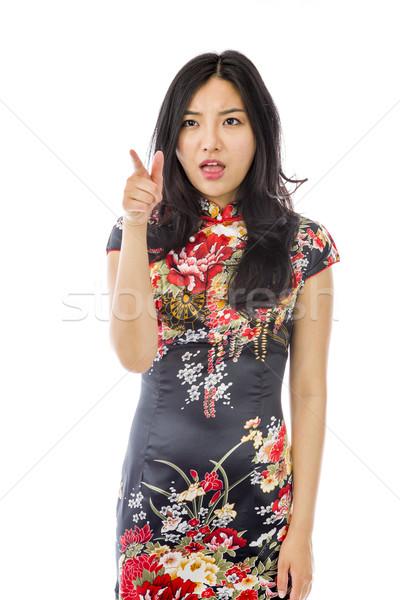 Asiático mulher jovem indicação isolado branco vestir Foto stock © bmonteny
