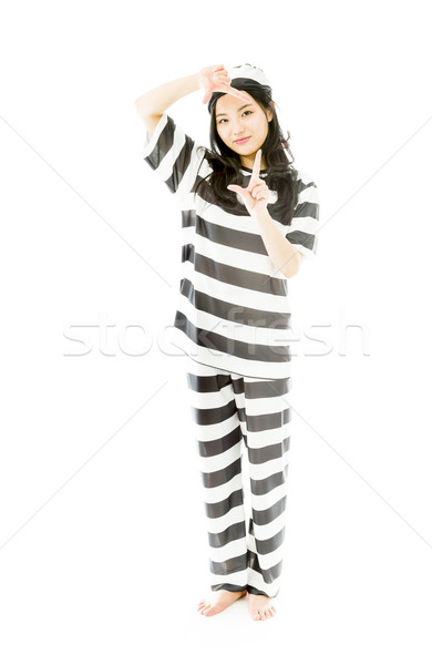 Young Asian woman making frame with fingers in prisoners uniform Stock photo © bmonteny