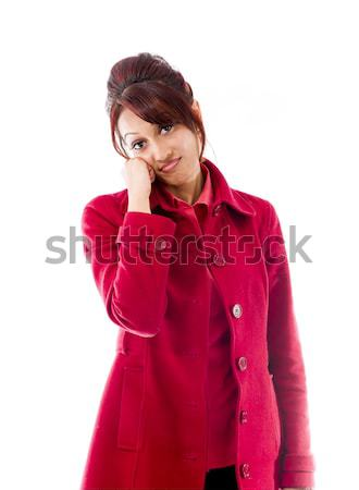 Indian young woman standing with head in hands Stock photo © bmonteny
