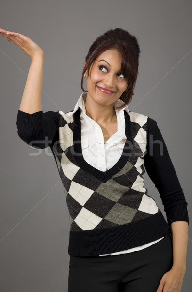 Happy Indian businesswoman presenting isolated on colored background Stock photo © bmonteny
