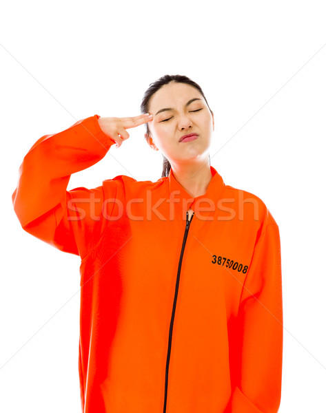 Young Asian woman shooting herself in head in prisoners uniform Stock photo © bmonteny