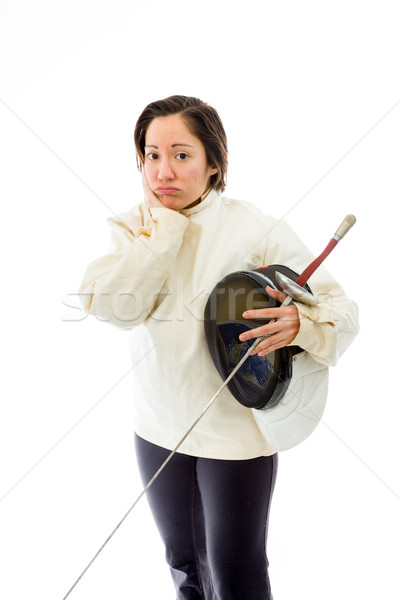 Stock photo: Female fencer looking sad with a holding mask and sword