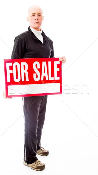 Senior homem venda assinar homens Foto stock © bmonteny