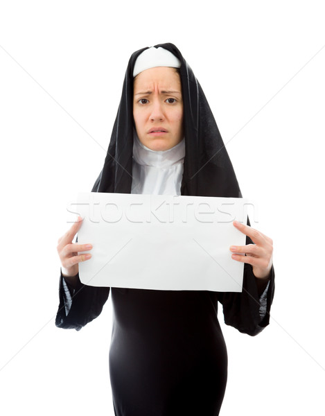 Young nun showing a blank placard Stock photo © bmonteny