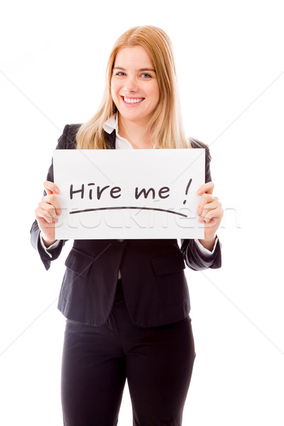 Businesswoman holding a message board with the text words 'Hire Stock photo © bmonteny