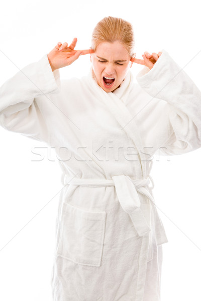 Young woman standing in bathrobe and looking frustrated Stock photo © bmonteny
