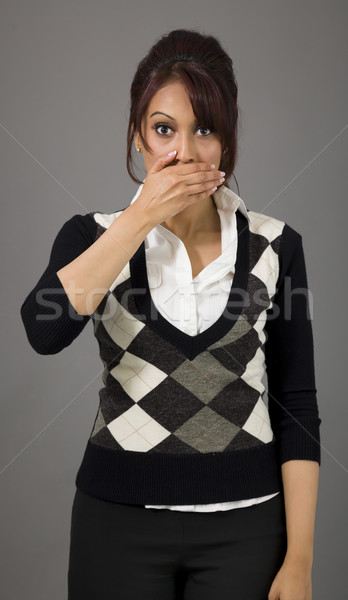 Indian businesswoman with hand over her mouth Stock photo © bmonteny