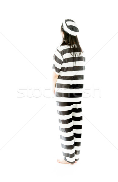 Rear view of an Asian young woman day dreaming in prisoners uniform Stock photo © bmonteny