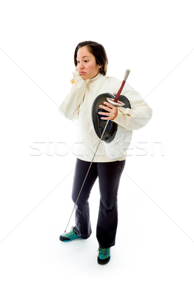 Female fencer looking sad with a holding mask and sword Stock photo © bmonteny