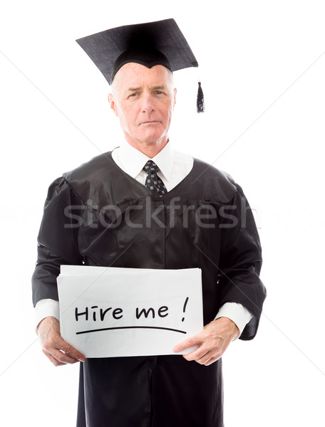 Senior male graduate holding a message board with the text words Stock photo © bmonteny