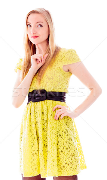 Beautiful young woman standing with her hand on hip Stock photo © bmonteny
