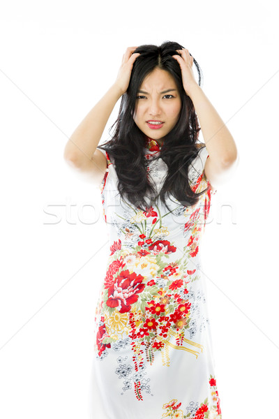 Frustrated Asian young woman pulling her hair Stock photo © bmonteny