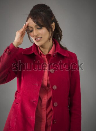 Indian young woman suffering from headache Stock photo © bmonteny