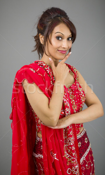 Young Indian woman making smiley face Stock photo © bmonteny
