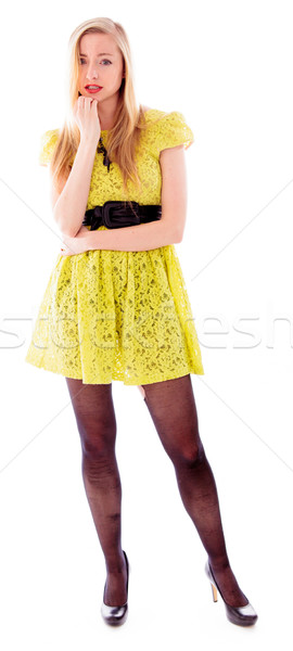 Beautiful young woman standing with her hand on chin Stock photo © bmonteny