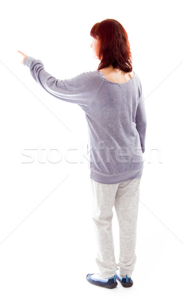 Stock photo: Rear view of a mature woman using imagery virtual screen