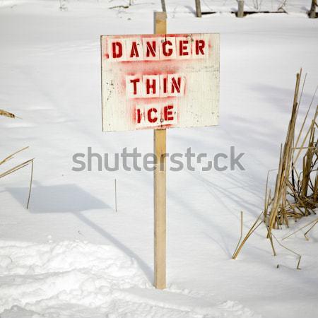 Warning sign of 'THIN ICE' at lakeside, Orangeville, Dufferin Co Stock photo © bmonteny