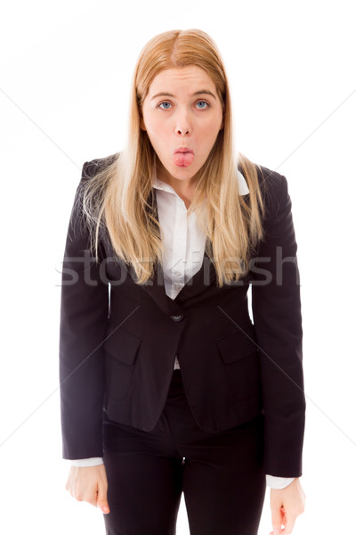 Businesswoman sticking out her tongue Stock photo © bmonteny