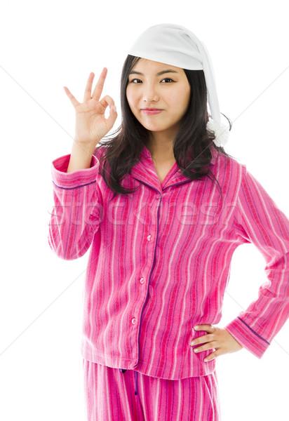 Jeunes asian femme signe Photo stock © bmonteny