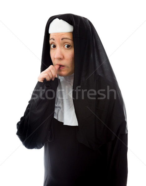 Nervous young nun biting nail Stock photo © bmonteny