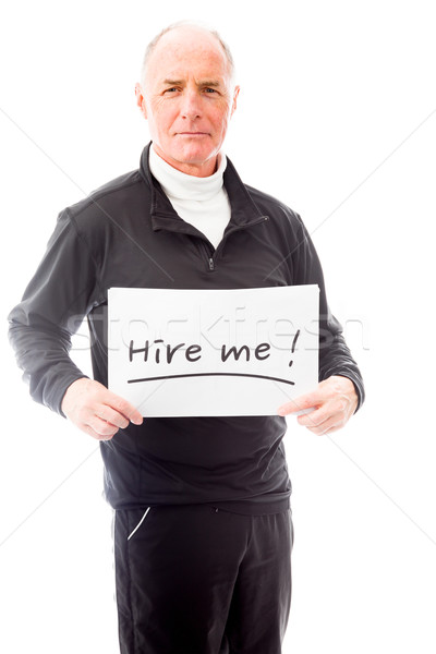 Senior man holding a message board with the text words 'Hire me' Stock photo © bmonteny
