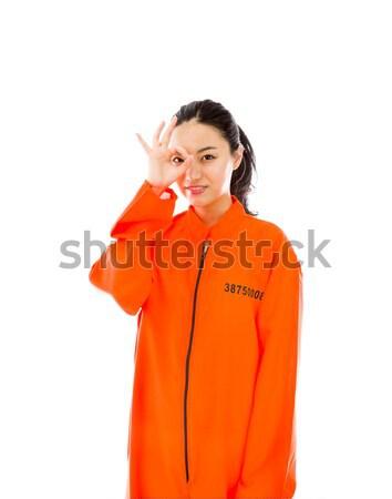 Jeunes asian femme uniforme orange droit Photo stock © bmonteny