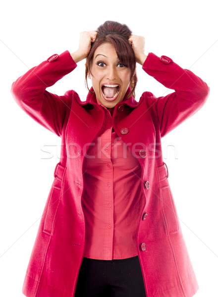 Indian young woman pulling her hair and screaming in frustration Stock photo © bmonteny