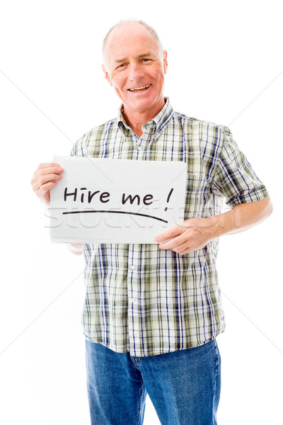 Stock photo: Senior man holding a message board with the text words