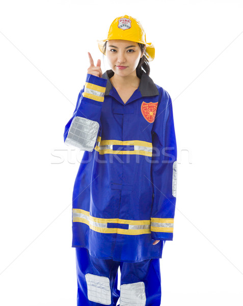 Lady firefighter pointing up Stock photo © bmonteny