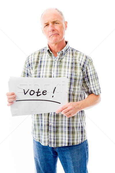 Senior man holding a message board with the text words 'Vote' Stock photo © bmonteny