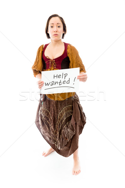 Young woman looking sad and showing help wanted sign on white ba Stock photo © bmonteny