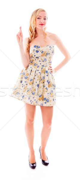 Beautiful young woman standing with her fingers crossed Stock photo © bmonteny