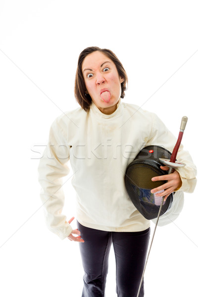 Female fencer sticking her tongue out Stock photo © bmonteny