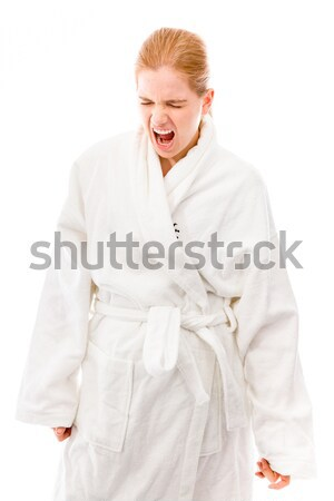 Young woman standing in bathrobe with finger on lips Stock photo © bmonteny