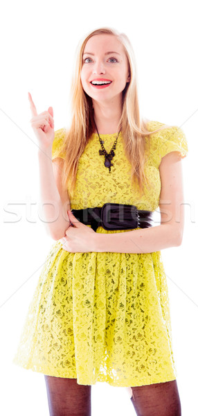 Beautiful young woman standing and pointing upward Stock photo © bmonteny