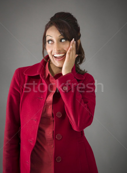 Surprised Indian woman with opened mouth looking happy isolated on colored background Stock photo © bmonteny