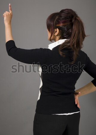Rear view of a businesswoman pretending to working on virtual screen Stock photo © bmonteny