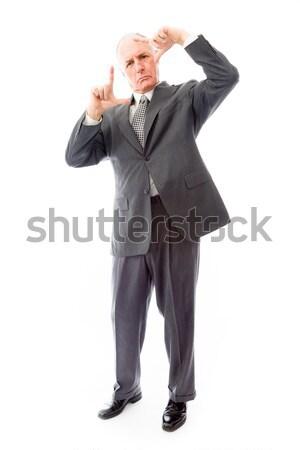 Empresário cara dedos gerente em pé vertical Foto stock © bmonteny