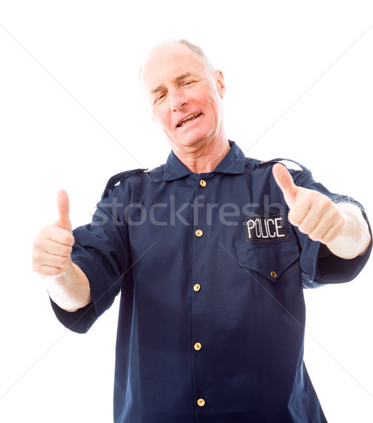 Policeman showing thumbs up gesture Stock photo © bmonteny
