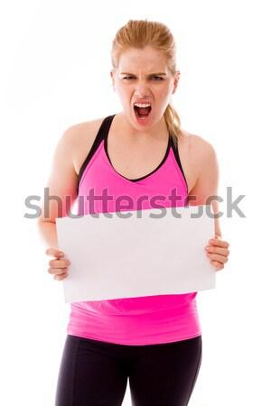 Młoda kobieta patrząc gniew wskazując Zdjęcia stock © bmonteny