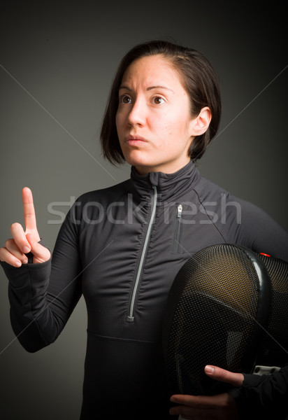 Female fencer pointing her finger up Stock photo © bmonteny