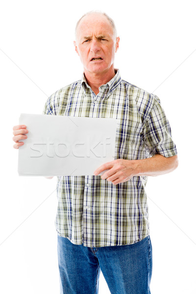 Frustrated senior man holding a blank placard Stock photo © bmonteny