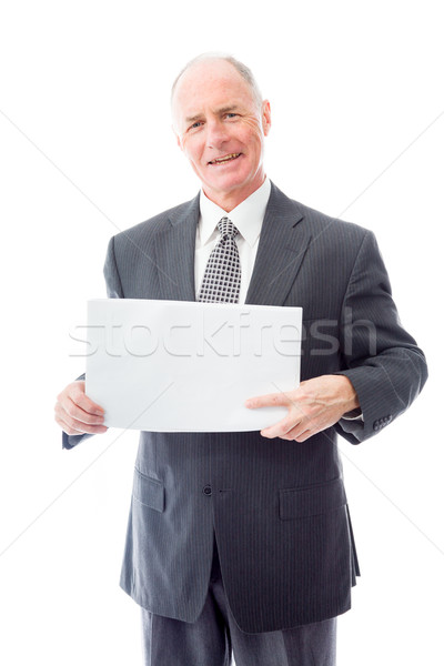Businessman holding a blank placard and smiling Stock photo © bmonteny