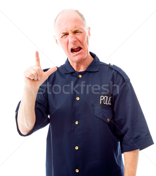 Frustrated policeman pointing up Stock photo © bmonteny