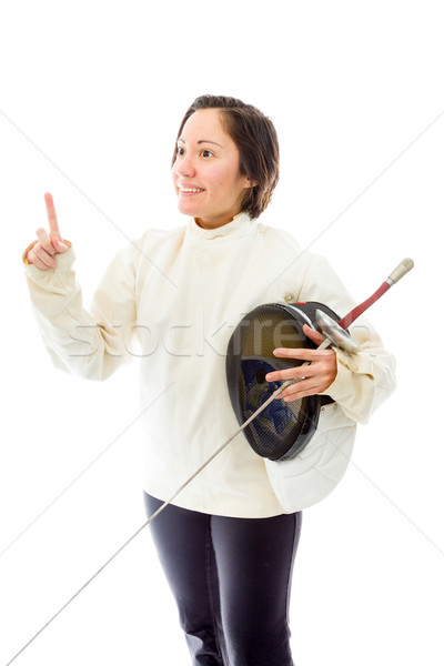 Female fencer holding a mask and sword with pointing upward Stock photo © bmonteny